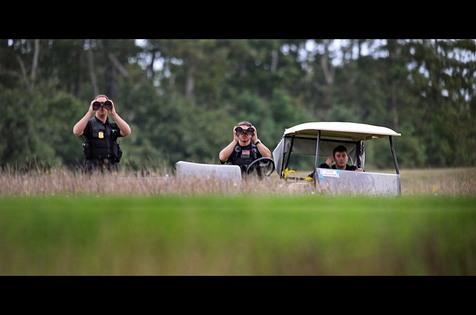 Secret Service Agents keep an eye on things as President Obama golfs at the Vineyard Golf Club during his vacation on Martha's Vineyard.