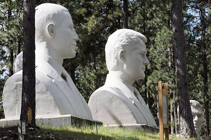 Giant cement busts of US Presidents Barack Obama, left, Bill Clinton, center, and Ronald Reagan, back right, are positioned in the Black Hills woods at the abandoned President's Park near Lead, South Dakota.
