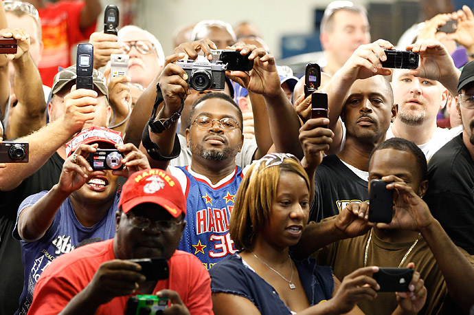 Ford Motor Company workers take pictures of President Obama at the Chicago Assembly Plant.