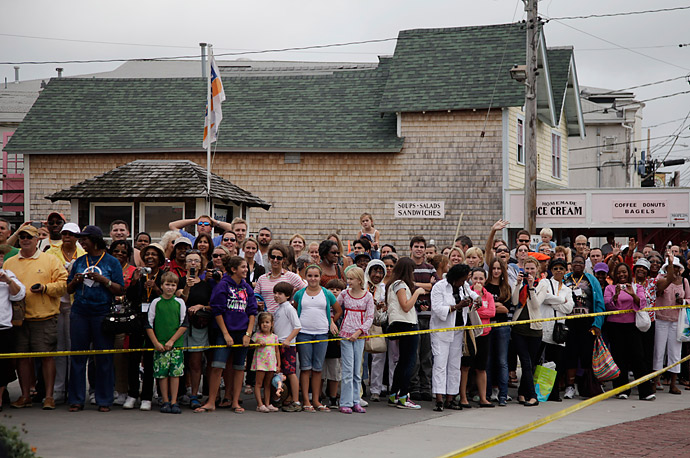 A crowd waits to get a glimpse of President Obama and the First Lady Michelle in Oak Bluffs, Mass., while the first family vacations on Martha's Vineyard.