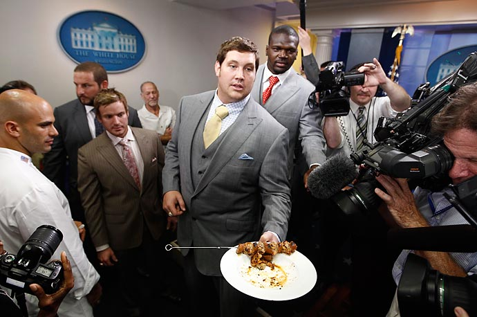 New Orleans Saints football team tackle Zach Strief serves Gulf shrimp and andouille sausage skewers in the briefing room of the White House after President Obama honored of the 2009 NFL Super Bowl Football Champions New Orleans Saints.