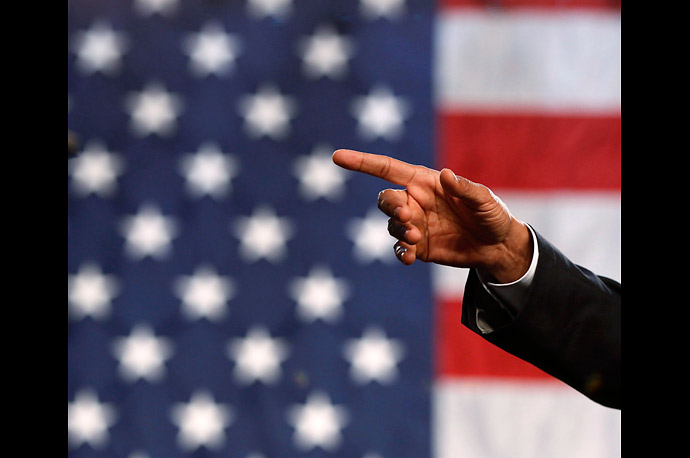 U.S. President Barack Obama gestures as he speaks about the economy at the Cuyahoga Community College West Campus in Parma, Ohio.