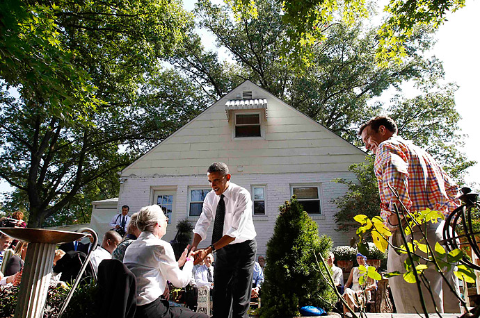 President Obama greets guests at a town-hall meeting in the yard of a Falls Church, Va., residence.