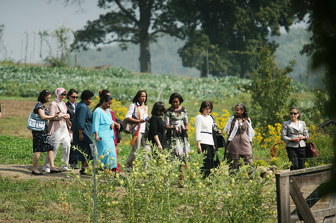 Michelle Obama (fourth from right) and other First Ladies tour an herb garden at Stone Barns Center for Food and Agriculture in Pocantico Hills, N.Y.