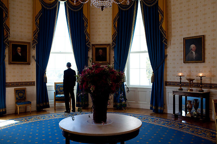 President Obama waits in the Blue Room of the White House before a news conference in the East Room.