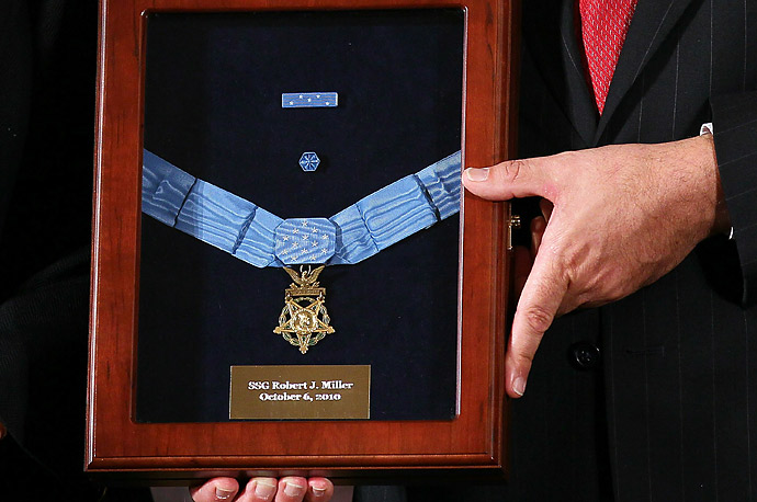 The Medal of Honor is presented to the family of Army Staff Sergeant Robert J. Miller at the White House.