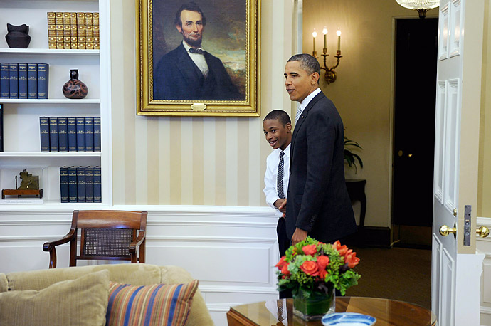 President Barack Obama surprises Anthony Black, one of the children featured in the documentry film