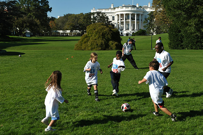 Local children talke part in a soccer clinic on the South Lawn of the White House. The clinic was part of US First Lady Michelle Obama's