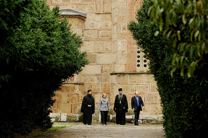 Secretary of State Hillary Clinton flanked by Bishop Teodosije (2ndR) tours the medieval Gracanica Serb Orthodox monastery, an important religious site, during her visit to Pristina on