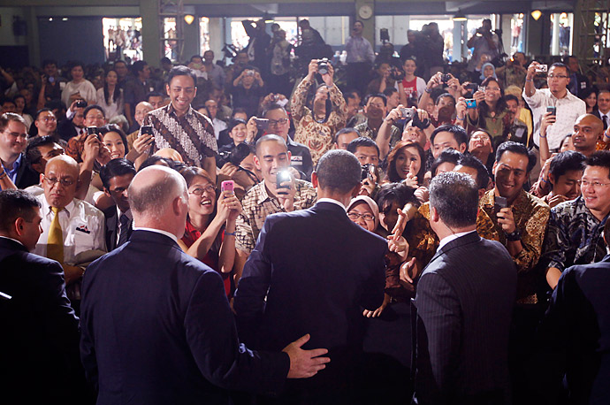 President Barack Obama greets the crowd after speaking at the University of Indonesia.