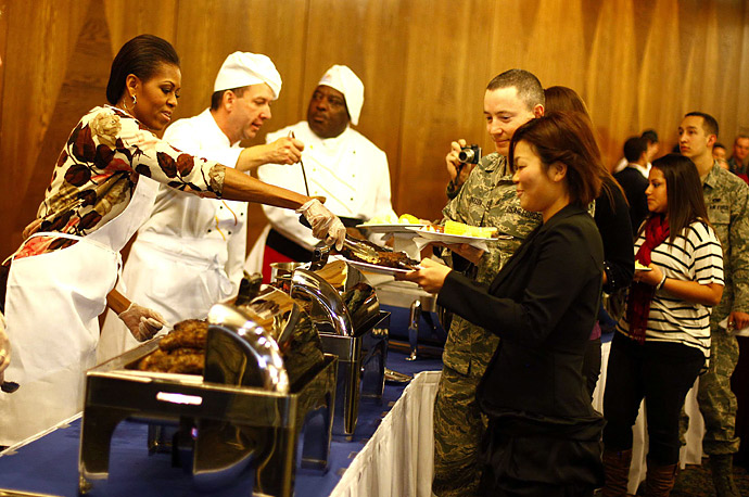 While the President attends the G20 in South Korea, the First Lady traveled to Germany where she served steaks to servicemen and their relatives at the U.S. base in Ramstein.