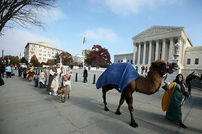 Christian activists wear biblical costumes as they participate in a procession outside the U.S. Supreme Court, November 22, 2010. The group Faith and Action held a live Christmas nativity scene