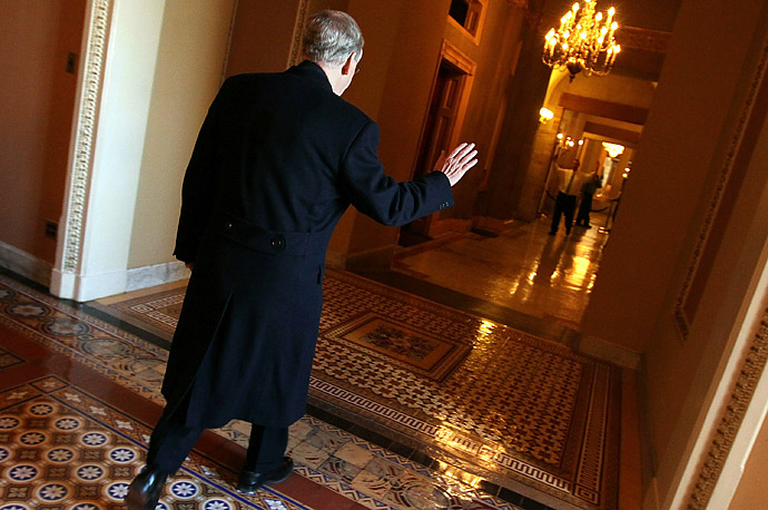 Senate Minority Leader Mitch McConnell walks towards his office in the U.S. Capitol. The Senate is continuing to debate the strategic nuclear arms limitation treaty (START) with Russia.