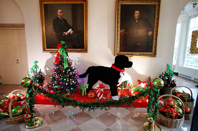 A large replica of the Obamas' family dog Bo, made from pipe cleaners, and other Christmas decorations are seen in the Booksellers area of the White House.