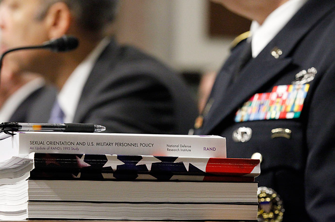 A report sits in front of the seat for Gen. Carter Ham, commander of the United States Army  Don't Ask Don't Tell' policy.