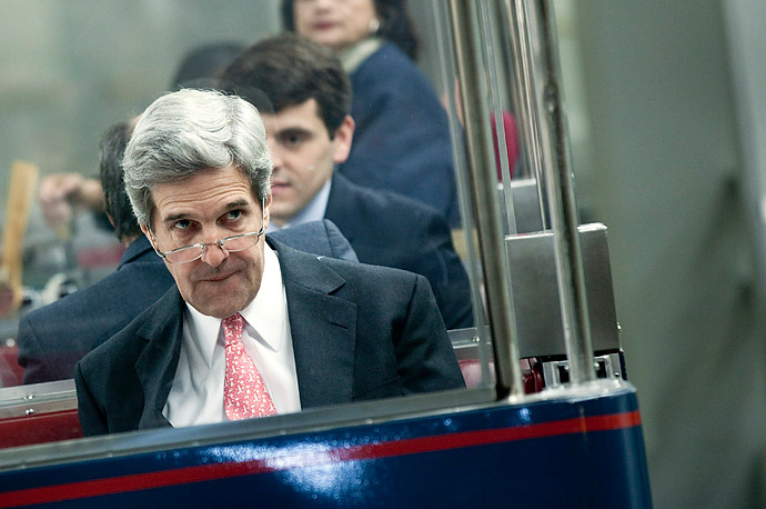 Senator John Kerry (D-MA) rides the Capitol Subway heading to vote on Capitol Hill.  The US House