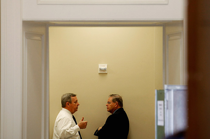Senate Majority Whip Sen. Richard Durbin (D-IL) (L) talks with Sen. Robert Menendez (D-NJ) in the hallway outside the Senate Democratic Caucus luncheon in the U.S. Captiol.