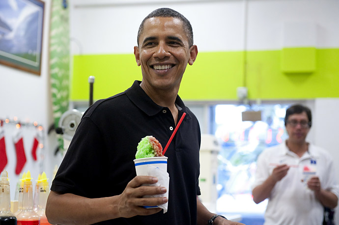 President Obama holds a shaved ice during a visit to Island Snow in Kailua, Hawaii.