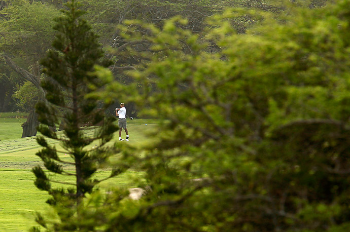 President Barack Obama watches his drive to the 9th green as he plays golf at the Mid-Pacific Country Club in Kailua, Hawaii.