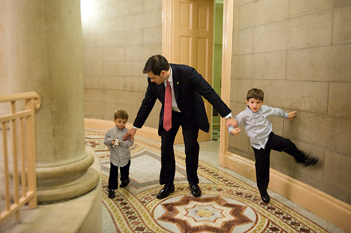 Senator Marco Rubio and his sons head to a swearing in ceremony for the 112th Congress in the Old Senate Chamber in Washington D.C.
