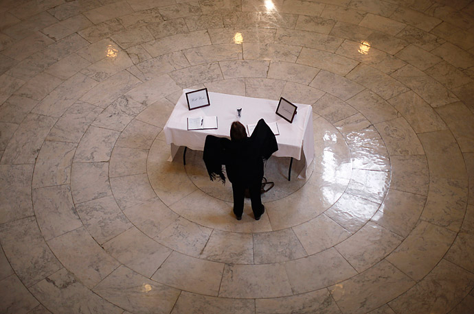A table with books of condolence and well wishes for Rep. Gabrielle Giffords, D-Ariz., and other victims of the shooting in Arizona stands in the rotunda of the Cannon House Office Building in Washington.