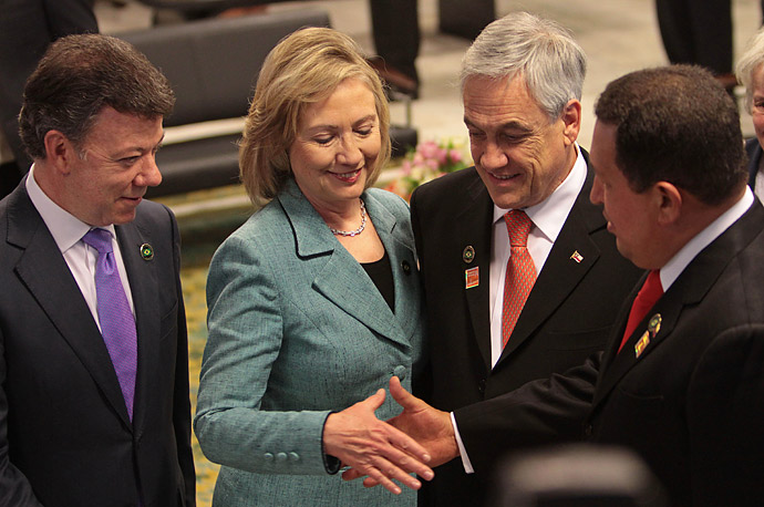 Secretary of State Hillary Clinton shakes hands with Venezuela's President Hugo Chavez, right, next to Colombia's President Juan Manuel Santos, left, and Chile's President Sebastian Pinera