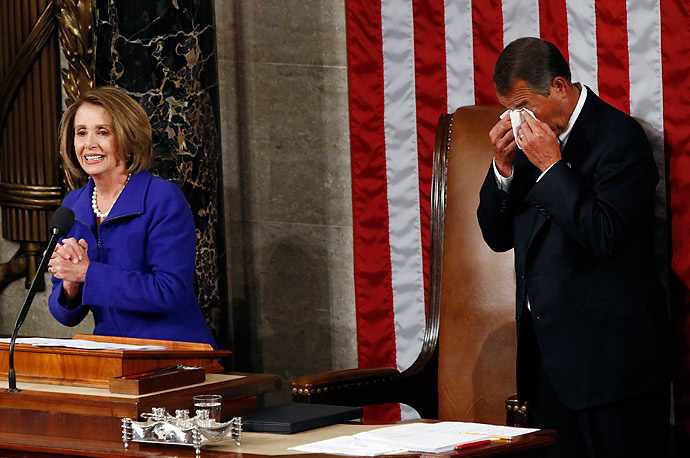 Incoming House Speaker John Boehner, right, cries as outgoing House Speaker Nancy Pelosi announces she is handing over power to him on the opening day of the 112th United States Congress on Capitol Hill in Washington, January 5, 2011.