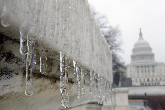 Icicles form on a statue near the Capitol Building in Washington. Freezing rain left icy conditions, closing schools and delaying the opening of the Federal government by two hours.
