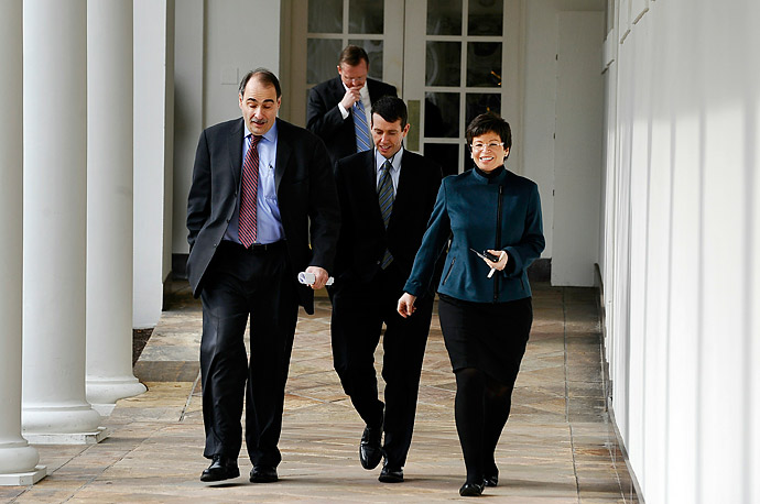 White House advisers Valerie Jarrett (R), David Plouffe (C) David Axelrod (L) and Press Secreatry Robert Gibbs walk along the colonnade outside the Oval Office on January 25, 2011.