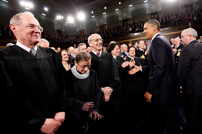 U.S. President Barack Obama greets Justices, from left, Anthony Kennedy, Ruth Bader Ginsburg, Stephen Breyer and Sonia Sotomayor prior to delivering his State of the Union address on Capitol