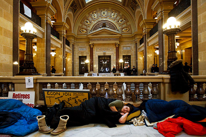 On the 10th day of protests, people opposing the governor's bill to eliminate collective bargaining rights for state workers sleep on the floor of the Assembly chambers at the state capitol in Madison, Wisconsin.