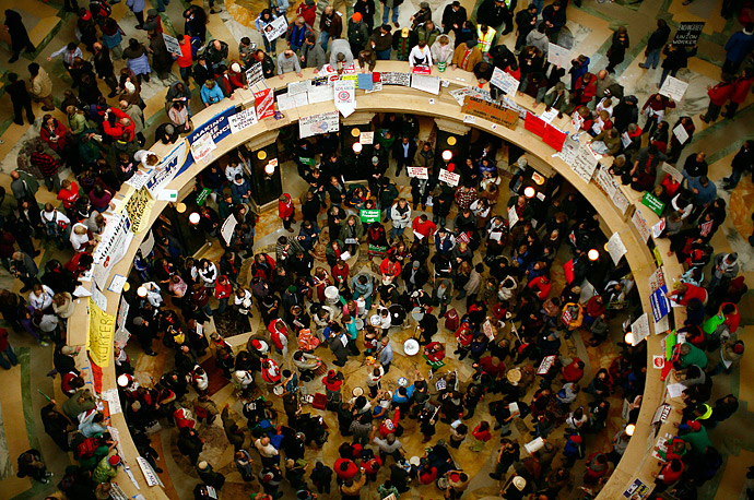 Demonstrators gather in the state capitol in Madison, Wisconsin to protest legislation proposed by Governor Scott Walker to restrict the collective bargaining power of public workers.