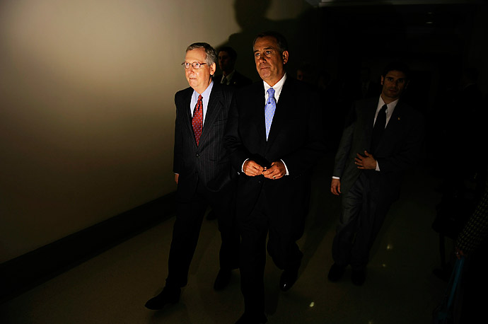 Senate majority leader Mitch McConnell, left, and House Speaker John Boehner head to a news conference at the Capitol.