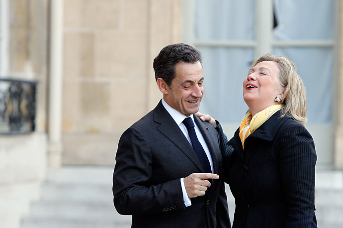 U.S. Secretary of State Hillary Clinton is welcomed by French President Nicolas Sarkozy in Paris.