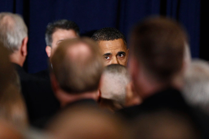 President Barack Obama leaves the stage after speaking about the conflict in Libya during an address at the National Defense University in Washington, March 28, 2011.