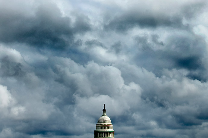 Storm clouds over hang over the dome of the U.S. Capitol building in Washington, D.C.