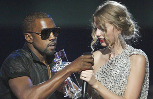 Kanye West takes the microphone from Taylor Swift as she accepts the