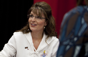 Former Alaska Governor Sarah Palin signs copies of her book,