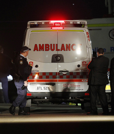 An ambulance arrives outside a house where bomb squad officers were working to protect an 18-year-old girl in the exclusive Sydney suburb of Mosman August 3, 2011