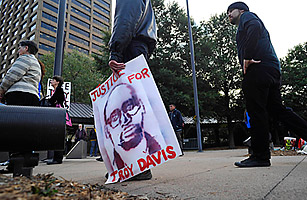 Supporters of Troy Davis protest outside of the Georgia Board of Pardons and Paroles on September 19, 2011. (Image courtesy of Reuters/CNN)