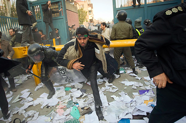 Iranian riot police stand guard as protesters gather outside the British embassy in Tehran on November 29, 2011. More than 20 Iranian protesters stormed the embassy, removing the mission's