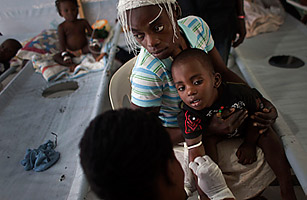 A woman holds her sick child as he receives treatment for cholera at a Doctors Without Borders, MSF, cholera clinic in Port-au-Prince, Haiti, Oct. 19, 2011. Ramon Espinosa / AP