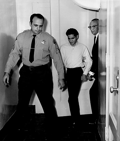 In this 1968 photo, released Wednesday, March 30, 2011 by the Shelby County Register's office via the Los Angeles Clounty Sheriff's Department, authorities escort Sirhan Sirhan at the Los Angeles County jail.