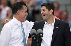 Republican presidential candidate, former Massachusetts Gov. Mitt Romney (L) and U.S. Rep. Paul Ryan (R-WI) (R) wave as Ryan is announced as his running mate aboard the USS Wisconsin Aug. 11, 2012 in Norfolk, Va.