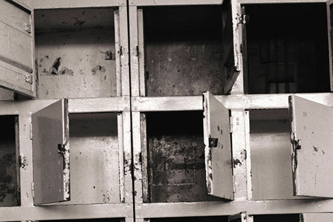 Image: A bank of lockers in the large communal cell provided storage for prisoners' possessions, 1994