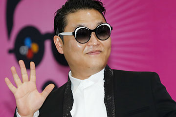South Korean rapper Psy poses during a news conference before his concert in Seoul on April 13, 2013.