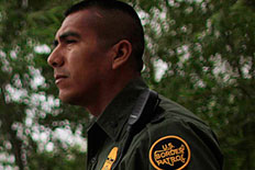 U.S. Border Patrol agent Daniel Tirado from the Rio Grande Valley Sector looks out at the Rio Grande river in Hidalgo, Texas, March 28, 2013.