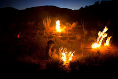 Fire is a tool, a gift, and a possible danger, which Anangu children learn at an early age in Watarru, one of many Aboriginal homelands where tradition still lights the way.