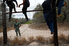 People are taken into custody by the U.S. Border Patrol near Falfurrias, Texas, March 29, 2013.
