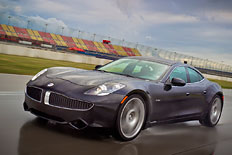 The 2012 Fisker Karma on wet race track in Fontana, California